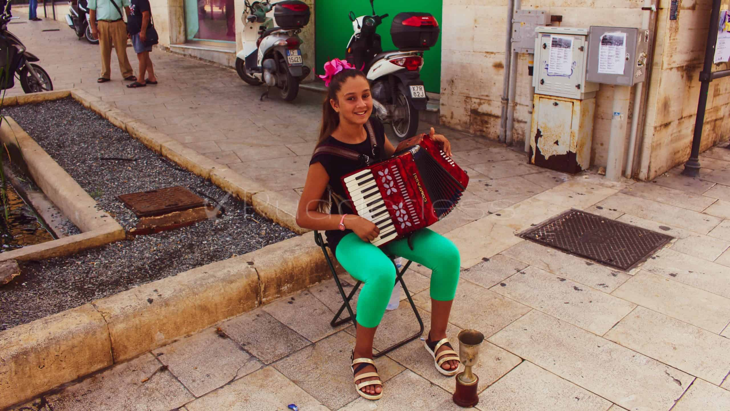 little girl play accordion in syracuse sicily